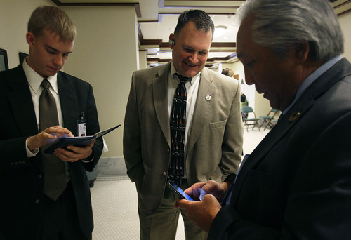 Scott Sommerdorf   |  The Salt Lake Tribune Clark Aposhian, center, speaks with Rep. Curt Oda, R-Clearfield, right, in the House building at the Utah State Capitol complex, Wednesday, February 6, 2013. Oda is considered the most active advocate of gun rights in the House. Aposhian spends long days at the capitol every day during the legislative session advocating for gun rights. At left is Oda's intern, Nate Osborne.