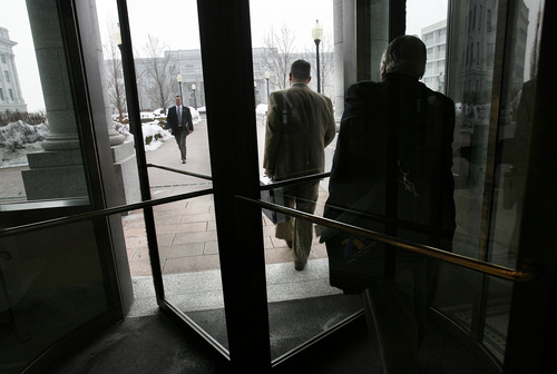 Scott Sommerdorf   |  The Salt Lake Tribune Clark Aposhian, center, heads through the revolving doors in the Senate building on his way to the House building at the Utah State Capitol complex, Wednesday, February 6, 2013. Aposhian spends long days at the capitol every day during the legislative session advocating for gun rights.