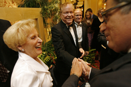 "Tribune file photo James LeVoy Sorenson, center, alongside his wife Beverly is congratulated by David Johaneson prior to his honoring by the Chamber of Commerce at the ""Giant in the City Party"" at the Grand America Hotel in 2006."