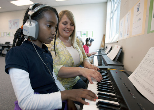 Steve Griffin | The Salt Lake Tribune Whittier Elementary School third grader, Fikir Teklemedhin, plays the piano for her music teacher, Melanie Witbeck, during class at the Salt Lake City school. The school is losing its federal Title I  funding next year, and a school-wide music program is threatened  by the loss. It gives every Whittier student a chance to learn music with an emphasis on the piano.