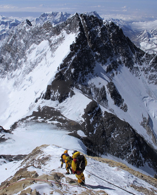 In this picture released by mountain guide Adrian Ballinger of Alpenglow Expeditions and taken Saturday, May 18, 2013, Climbers descend from the summit of Mount Everest, in the Khumbu region of the Nepal Himalayas. Nepal celebrated the 60th anniversary of the conquest of Mount Everest on Wednesday, May 29, 2013, by honoring climbers who followed in the footsteps of Edmund Hillary and Tenzing Norgay. (AP Photo/Alpenglow Expeditions, Adrian Ballinger)