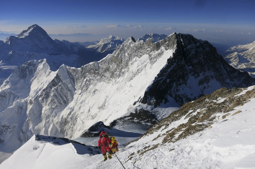 In this image released by mountain guide Adrian Ballinger of Alpenglow Expeditions and taken Saturday, May 18, 2013, climbers make their way to the summit of Mount Everest, in the Khumbu region of the Nepal Himalayas. Nepal celebrated the 60th anniversary of the conquest of Mount Everest on Wednesday, May 29, 2013, by honoring climbers who followed in the footsteps of Edmund Hillary and Tenzing Norgay. (AP Photo/Alpenglow Expeditions, Adrian Ballinger) MANDATORY CREDIT, EDITORIAL USE ONLY