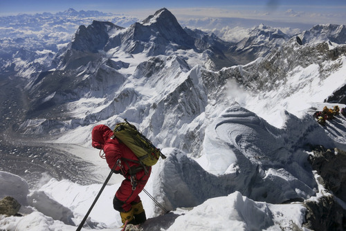 In this image released by mountain guide Adrian Ballinger of Alpenglow Expeditions and taken Saturday, May 18, 2013, a climber prepares to descend the Hillary Step as he makes his way down from the summit of Mount Everest, in the Khumbu region of the Nepal Himalayas. Nepal celebrated the 60th anniversary of the conquest of Mount Everest on Wednesday, May 29, 2013, by honoring climbers who followed in the footsteps of Edmund Hillary and Tenzing Norgay. (AP Photo/Alpenglow Expeditions, Adrian Ballinger) MANDATORY CREDIT, EDITORIAL USE ONLY
