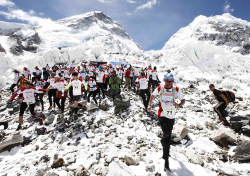 In this photograph provided by Himex Nepal, participants of the Tenzing Hillary Everest Marathon begin their race at the Everest base camp in the Khumbu region of the Nepal Himalayas, Wednesday, May 29, 2013. Nepal celebrated the 60th anniversary of the conquest of Mount Everest on Wednesday by honoring climbers who followed in the footsteps of Edmund Hillary and Tenzing Norgay. (AP Photo/Himex Nepal,Dinesh Gole)