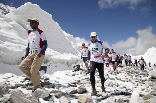 In this photograph provided by Himex Nepal, participants of the Tenzing Hillary Everest Marathon begin their race at the Everest base camp in the Khumbu region of the Nepal Himalayas, Wednesday, May 29, 2013. Nepal celebrated the 60th anniversary of the conquest of Mount Everest on Wednesday by honoring climbers who followed in the footsteps of Edmund Hillary and Tenzing Norgay. (AP Photo/Himex Nepal, Dinesh Gole)