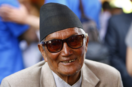 Nepalese mountaineer Min Bahadur Sherchan, 81, participates in a function to mark the 60th anniversary of the successful ascent of Mount Everest at the British Embassy, in Katmandu, Nepal, Wednesday, May 29, 2013. Sherchan had held the record for the oldest person to scale the world's highest mountain until 80-year-old Japanese climber Yuichiro Miura conquered the 8,850-meter (29,035-foot) peak last week. (AP Photo/Niranjan Shrestha)