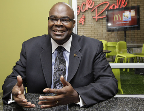 """FILE - In this Thursday June 10, 2010, file photo, McDonald's President Don Thompson,speaking during an interview with the Associated Press in Sandton, Johannesburg, South Africa. McDonald's CEO Don Thompson revealed at an analyst conference during the last week of May 2013 that he shed about 20 pounds in the past year by """"working out again,"""" but still eats McDonald's every day. (AP Photo/Yves Logghe, File)"""