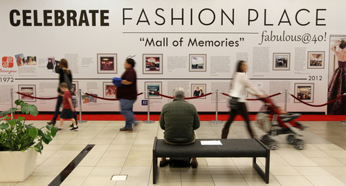 "Al Hartmann  |  The Salt Lake Tribune Shoppers pass by a ""Mall of Memories"" wall commemorating Fashion Place Mall's 40th anniversary in Murray Monday October 15.  The mall is commemorating its four-decade history with a weeklong celebration for shoppers, including exclusive offers, giveaways, retro fashion shows and a mall-wide birthday party honoring 40 kids affected by cancer."