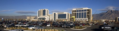 Cars fill the parking area of the new Intermountain Medical Center in Murray Nov. 16, 2007. Intermountain Healthcare owns 10 properties in Murray besides its new 63-acre campus. Several of those surround the campus like a buffer. The demand for medical office space nearby, and living options for doctors and nurses as well, has attracted a slough of development interest. Steve Griffin/The Salt Lake Tribune 11/16/07