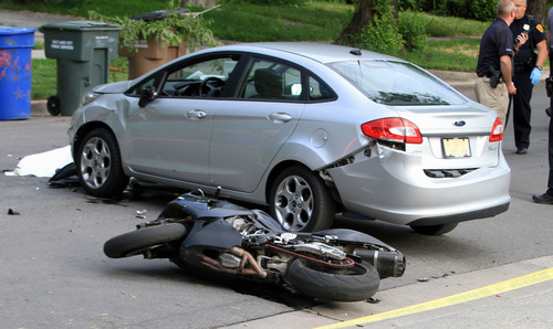 Rick Egan  | The Salt Lake Tribune   Salt Lake City Police investigate a motorcycle accident near 1400 South and West Temple, Wednesday, May 29, 2013.
