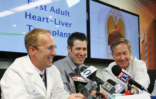 Steve Griffin | The Salt Lake Tribune Mike Mader, 31, of Salt Lake City, center, laughs as two of his doctors, John Doty, left, and Willem Van der Werf, describe his recent heart and liver transplant during a news conference at Intermountain Medical Center in Murray on Thursday. The medical center performed the first-ever heart/liver transplant in the Intermountain West on April 23, 2013.