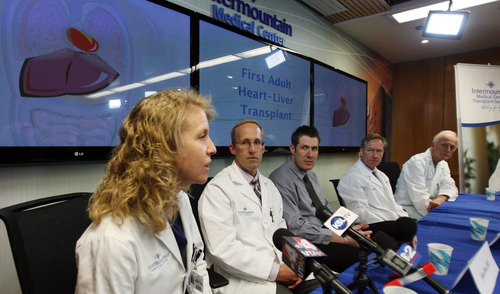 Steve Griffin |  The Salt Lake Tribune Mike Mader, 31, of Salt Lake City, center, listens as his doctors describe his recent heart and liver transplant during a news conference at Intermountain Medical Center in Murray on Thursday May 30, 2013. The medical center performed the first-ever heart/liver transplant in the Intermountain West on April 23, 2013. With Mader at the news conference were doctors Deborah Budge, John Doty, Willem Van der Werf and Kent Jones.