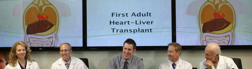Steve Griffin  |  The Salt Lake Tribune Mike Mader, 31, of Salt Lake City, center, laughs as his doctors describe his recent heart and liver transplant during a news conference at Intermountain Medical Center in Murray, Utah on Thursday. The medical center performed the first-ever heart/liver transplant in the Intermountain West on April 23, 2013. With Mader at the news conference were doctors Deborah Budge, John Doty, Willem Van der Werf and Kent Jones.