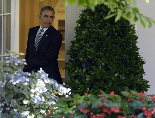 President Barack Obama walks out of the Oval Office to join college students in the Rose Garden of the White House in Washington, Friday, May 31, 2013, where he called on Congress to keep federally subsidized student loans rates from doubling on July 1.(AP Photo/Susan Walsh)