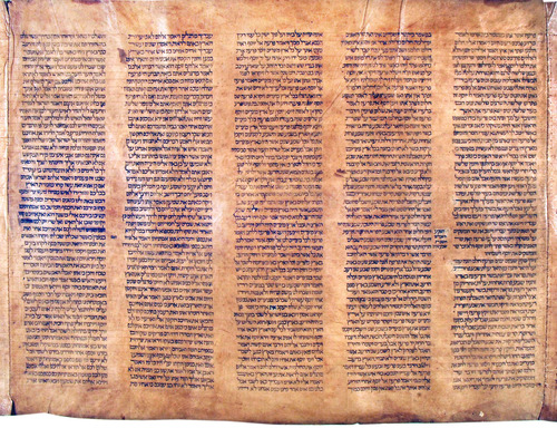In this undated photo provided by Alma mater Studiorum Universita' di Bologna, part of a document that an Italian expert says to be the oldest known complete Torah scroll. An Italian expert in Hebrew manuscripts says he has found the oldest known complete Torah scroll, a sheepskin document dating from 1155-1225. It was right under his nose, in the library of the University of Bologna, where it had been mistakenly catalogued a century ago as dating from the 17th century. Mauro Perani, a professor of Hebrew in the university's cultural heritage department, was updating the library's Hebrew manuscript catalogue when he stumbled upon the scroll in February. In an interview Wednesday, May 29, 2013 Perani said he immediately recognized that it had been wrongly dated given its script and other graphic notations. Two separate carbon-14 dating tests confirmed the revised dating. (AP Photo/Alma Mater Studiorum Universita' di Bologna)