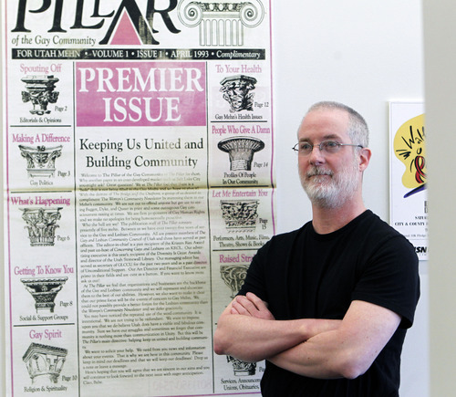 Al Hartmann  |  The Salt Lake Tribune David Nelson stands next to LGBT posters he donated to the political archives at the University of Utah's Marriott Library.