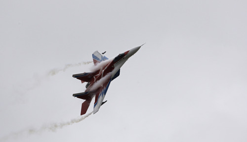 FILE - In this Friday, Aug. 21, 2009 file photo, a Russian-made MiG-29 jet fighter flown by the aerobatic team Strizhi (Swifts) perform during MAKS (the International Aviation and Space Show) in Zhukovsky, outside Moscow, Russia. Russian arms manufacturer MiG told Russian news agencies Friday, May 31, 2013 that it is signing a contract to deliver at least 10 fighter jets to Syria. (AP Photo/Sergey Ponomarev, File)