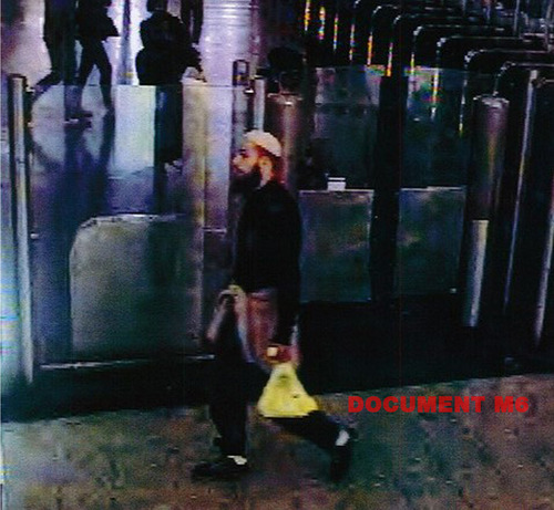 This still image taken from footage taken from a security camera Saturday May 25, 2013, and provided by French private TV station M6 on Wednesday May 29, 2013, shows the 22-year-old French suspect, identified only by his first name Alexandre, as he was strolling in a mall before stabbing a French soldier who was patrolling at the La Defense financial and shopping district, north of Paris, France. Traces of DNA on an orange juice bottle and a surveillance video of a man praying in a mall led to the arrest Wednesday of a young suspect accused of stabbing a French soldier who was patrolling a crowded area just outside Paris, officials said. (AP Photo/M6) FRANCE OUT ONLINE OUT