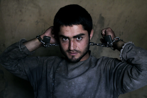 Amanullah , 20, a drug addict, is chained to a wall during his 40-day incarceration at the Mia Ali Baba shrine in Jalalabad, Afghanistan, Saturday, June 1, 2013. It is believed locally that 40 days chained to a wall and with a restricted diet of only water, black pepper and bread at the 300-year old shrine can cure the mentally ill, drug addicts and those possessed by spirits. If a shrine keeper decides their situation is improving, they may be unchained for a few minutes so they can pray, walk outside or visit a proper bathroom. (AP Photo/Rahmat Gul)