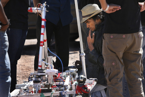 "Scott Sommerdorf  |  The Salt Lake Tribune Jagadeesh RB, of the SRM University team from Chennai, India, ponders their rover's problems as the team works to get it ready to take to the South course at the University Rover Challenge outside Hanksville, Friday May 31, 2013. The rovers were required to navigate the course and distribute items to various ""astronauts"" along the course. Their rover was not able to get going."