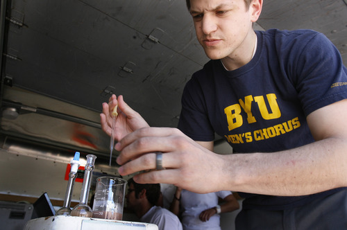 Scott Sommerdorf  |  The Salt Lake Tribune Brandon Llewellyn of BYU performs a chemical test on samples of soil at the University Rover Challenge outside Hanksville, Friday May 31, 2013.