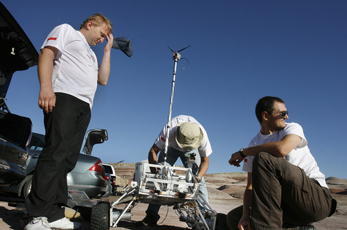 Scott Sommerdorf  |  The Salt Lake Tribune The SKNL Polish Rover team deals with frustrating technical difficulties at the University Rover Challenge outside Hanksville, Friday, May 31, 2013. Their rover had communications issues and was not able to traverse the course.