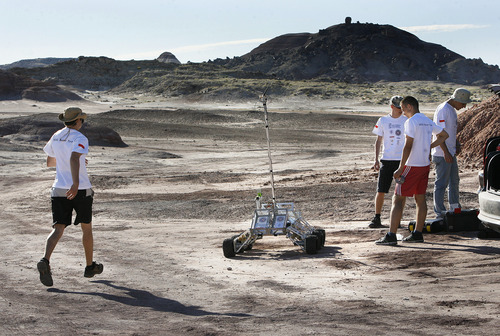 Scott Sommerdorf  |  The Salt Lake Tribune The SKNL Polish Rover team hurries to deal with frustrating technical difficulties before their allotted time runs out at the University Rover Challenge outside Hanksville, Friday May 31, 2013. Their rover ended up with communications issues and was not able to traverse the course.