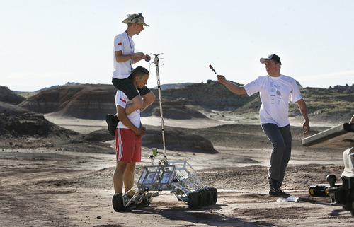Scott Sommerdorf  |  The Salt Lake Tribune The SKNL Polish Rover team uses some clever problem-solving as they hurry to deal with frustrating technical difficulties before their allotted time runs out at the University Rover Challenge outside Hanksville, Friday May 31, 2013. But their rover had communications issues and was not able to traverse the course.