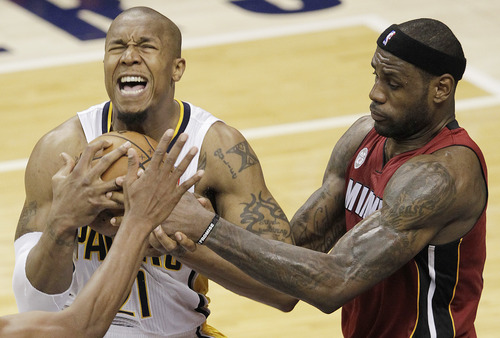 Indiana Pacers forward David West battles for the ball with Miami Heat forward LeBron James during the second half of Game 6 of the NBA Eastern Conference basketball finals in Indianapolis, Saturday, June 1, 2013. (AP Photo/AJ Mast)