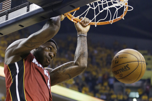 Miami Heat forward LeBron James dunks during the first half of Game 6 of the NBA Eastern Conference basketball finals against the Indiana Pacers in Indianapolis, Saturday, June 1, 2013. (AP Photo/Michael Conroy)