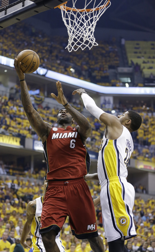 Miami Heat forward LeBron James (6) goes up for a shot against Indiana Pacers forward Paul George (24) during the first half of Game 6 of the NBA Eastern Conference basketball finals in Indianapolis, Saturday, June 1, 2013. (AP Photo/Michael Conroy)