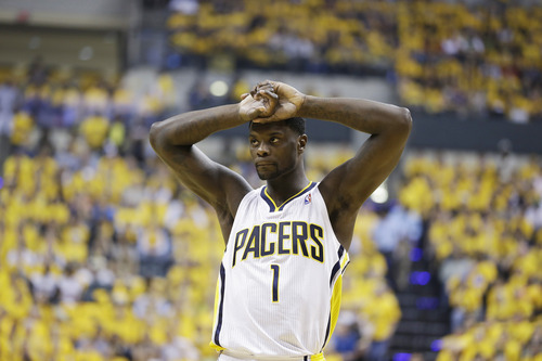 Indiana Pacers guard Lance Stephenson (1) reacts during the first half of Game 6 of the NBA Eastern Conference basketball finals against the Miami Heat in Indianapolis, Saturday, June 1, 2013. (AP Photo/Michael Conroy)
