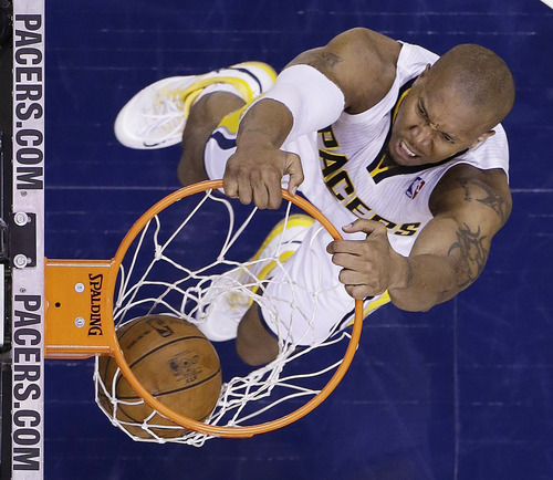 Indiana Pacers forward David West dunks against the Miami Heat during the second half of Game 6 of the NBA Eastern Conference basketball finals in Indianapolis, Saturday, June 1, 2013. (AP Photo/Michael Conroy)
