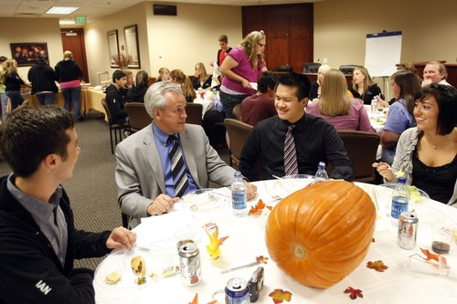 Photo by Chris Detrick     The Salt Lake Tribune  Cottonwood Heights Youth City Council members (l-r) Ian Bradley, Andy Cheng and Sarika Khanwilkar talk with Mayor Kelvyn Cullimore during a dinner with Cottonwood Heights City Council members Tuesday September 29, 2009.