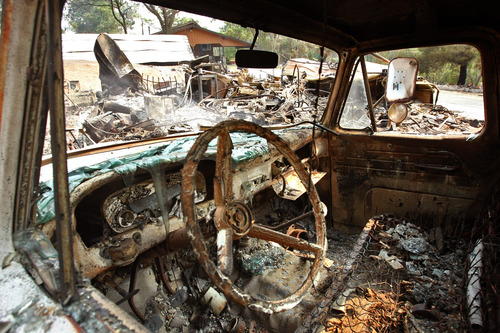 The charred interior of a truck was damaged along with a storage structure that was burned to the ground due to the  Powerhouse fire in Lake Hughes, Sunday, June 2, 2013. (AP Photo/Los Angeles Times, Genaro Molina)  NO FORNS; NO SALES; MAGS OUT; ORANGE COUNTY REGISTER OUT; LOS ANGELES DAILY NEWS OUT; VENTURA COUNTY STAR OUT; INLAND VALLEY DAILY BULLETIN OUT; MANDATORY CREDIT, TV OUT