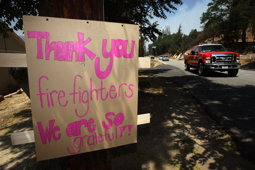 A sign shows gratitude to the firefighters who saved homes from the Powerstation fire  in Lake Hughes on Sunday, June 2, 2013. Erratic winds fanned a blaze in the Angeles National Forest to nearly 41 square miles early Sunday, after fast-moving flames triggered the evacuation of nearly 1,000 homes in Lake Hughes and Lake Elizabeth, officials said. (AP Photo/Los Angeles Times, Genaro Molina)  NO FORNS; NO SALES; MAGS OUT; ORANGE COUNTY REGISTER OUT; LOS ANGELES DAILY NEWS OUT; VENTURA COUNTY STAR OUT; INLAND VALLEY DAILY BULLETIN OUT; MANDATORY CREDIT, TV OUT