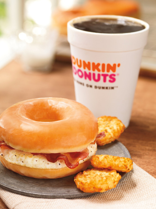 (AP Photo/Dunkin' Brands, Inc., James Scherer) Beginning Friday, Dunkin' Donuts will offer a glazed donut breakfast sandwich, complete with bacon and egg.