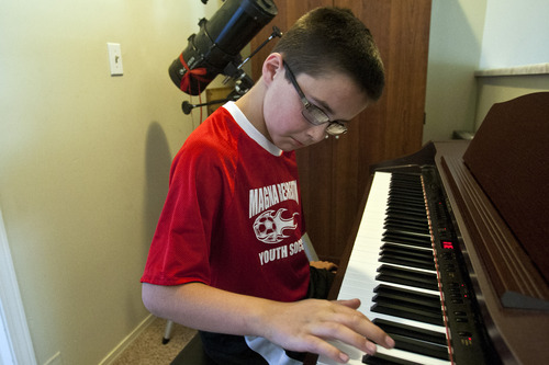 Chris Detrick  |  The Salt Lake Tribune Danny Fish, 9, practices the piano at his home in Magna on Thursday, May 30, 2013.
