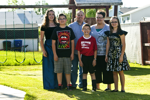Chris Detrick  |  The Salt Lake Tribune The Fish family: Natalie, 17, Brady, 12, Derek, Danny, 9, Becky and Laurel, 16, at their home in Magna on Thursday, May 30, 2013.