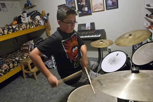Chris Detrick  |  The Salt Lake Tribune Brady Fish, 12, practices the drums in his bedroom at his home in Magna pn Thursday, May 30, 2013.