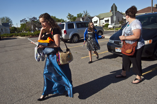 Chris Detrick  |  The Salt Lake Tribune Natalie and Laurel Fish and their mom, Becky, walk to Cyprus High School before their choir concert in Magna on Thursday, May 30, 2013.