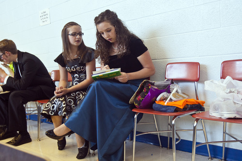 Chris Detrick  |  The Salt Lake Tribune Laurel Fish, 16, and her sister, Natalie, 17, wait at Cyprus High School before a choir concert in Magna on Thursday, May 30, 2013.