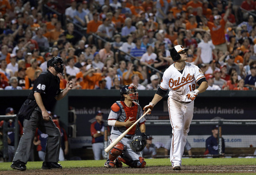 Baltimore Orioles' Chris Davis watches his two-run home run in the seventh inning of an interleague baseball game against the Washington Nationals, Wednesday, May 29, 2013, in Baltimore. Baltimore won 9-6. (AP Photo/Patrick Semansky)