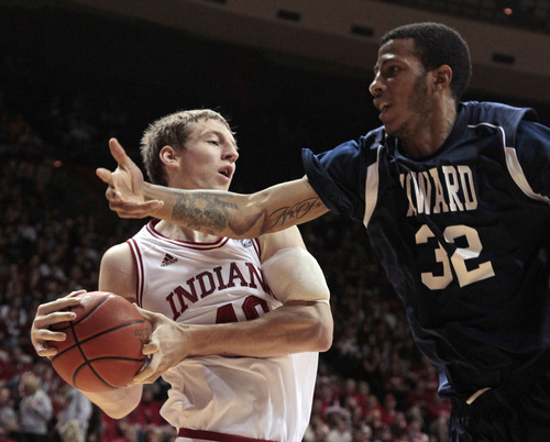 Indiana's Cody Zeller grabs a rebound against Howard's Alphonso Leary during the first half of an NCAA college basketball game Monday, Dec. 19, 2011, in Bloomington, Ind. (AP Photo/Darron Cummings)