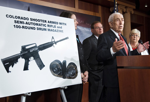 FILE - In this July 24, 2012 file photo, Sen. Frank Lautenberg, D-N.J., center, leads a news conference on Capitol Hill in Washington, to criticize the sale of high-capacity magazines for assault rifles that are sold to the public. Lautenberg, a longtime advocate of gun control, died Monday; June 3; 2013 at age 89. He returned to the Senate in April 2013 despite poor health for several votes on gun legislation favored by President Barack Obama. From left are Rep. Diana DeGette, D-Colo.; Sen. Robert Menendez, D-N.J.; Lautenberg, and Rep. Carolyn McCarthy, D-N.Y. (AP Photo/J. Scott Applewhite, File)