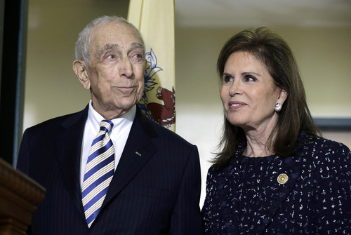 FILE - In this Feb. 15, 2013 file photo, Sen. Frank Lautenberg, D-NJ, stands with wife Bonnie Englebardt Lautenberg, in Paterson, N.J., where he announced plans to retire. Lautenberg, a multimillionaire businessman who became an accomplished politician, died Monday, June 3, 2013, in a New York hospital after suffering complications from viral pneumonia. He was 89.  (AP Photo/Mel Evans, File)