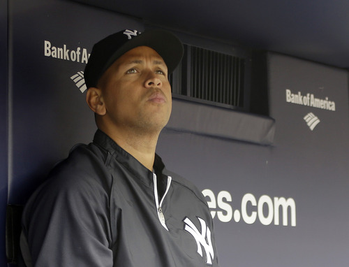 File- This April 13, 2013 file photo shows New York Yankees Alex Rodriguez sitting in the dugout during a baseball game at Yankee Stadium in New York. Steinbrenner says he has been disappointed by Alex Rodriguez's behavior at times during the star third baseman's career in pinstripes.  Steinbrenner made the comments after attending a news conference at Yankee Stadium on Monday to announce that the Big Ten and Pinstripe Bowl have agreed to an eight-year deal. Rodriguez is rehabbing his surgically repaired hip and is not expected back until after the All-Star break. Steinbrenner says the Yankees really need the three-time MVP to come back strong (AP Photo/Kathy Willens, File)