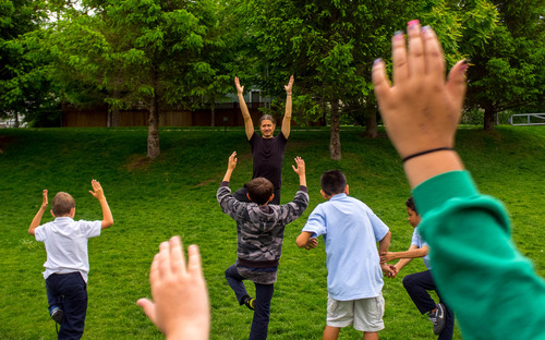 Trent Nelson  |  The Salt Lake Tribune Scott Moore teaches a yoga class at Alianza Academy in South Salt Lake on Wednesday, May 29, 2013.