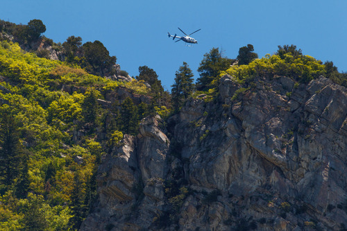 Trent Nelson  |  The Salt Lake Tribune A helicopter circles above the Y Mountain trailhead, where the search for a missing hiker continued Tuesday June 4, 2013 in Provo.