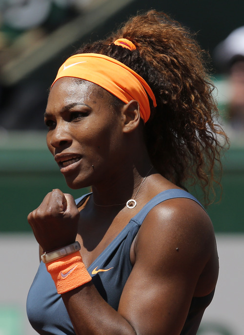 Serena Williams, of the U.S, reacts as she plays Russia's Svetlana Kuznetsova during their quarterfinal match of the French Open tennis tournament at the Roland Garros stadium Tuesday, June 4, 2013 in Paris. (AP Photo/Christophe Ena)